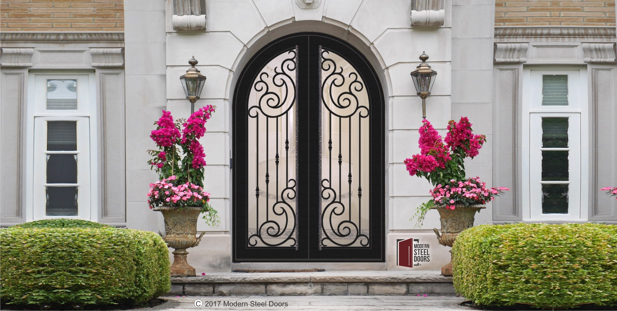 rustic transitional double entry doors with scroll designs and long custom door pulls